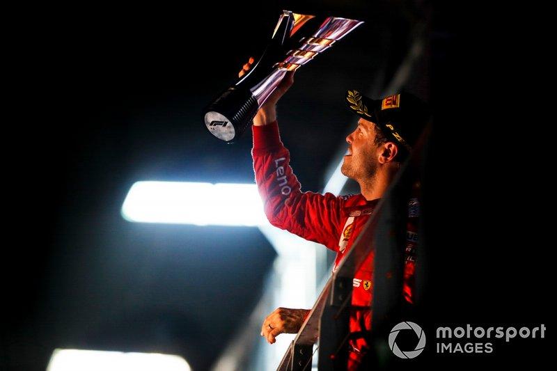 Race winner Sebastian Vettel, Ferrari, with his trophy