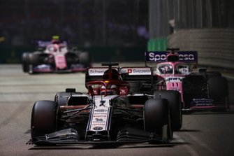 Kimi Raikkonen, Alfa Romeo Racing C38, leads Sergio Perez, Racing Point RP19, and Lance Stroll, Racing Point RP19