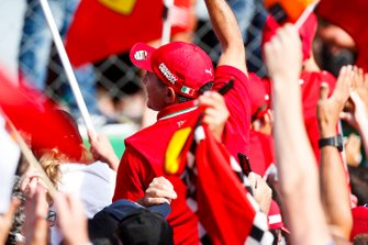 Fans celebrate a win for Ferrari on home turf