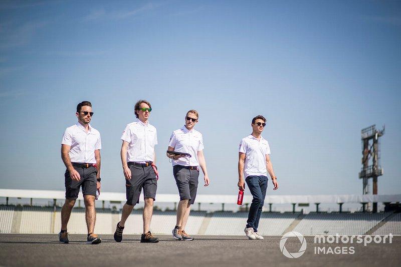 Lando Norris, McLaren walks the track with his mechanics