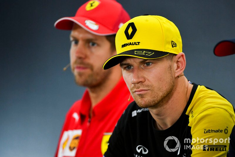 Nico Hulkenberg, Renault F1 Team and Sebastian Vettel, Ferrari In the Press Conference