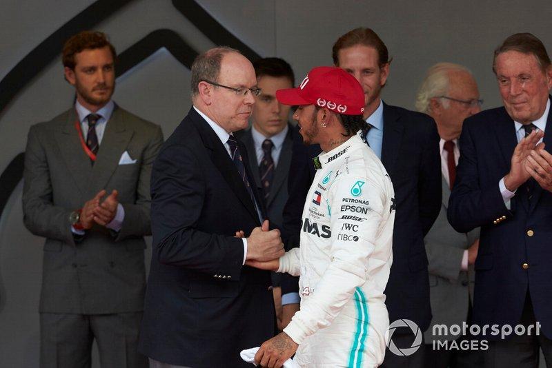 Prince Albert II of Monaco congratulates Lewis Hamilton, Mercedes AMG F1, 1st position, on the podium
