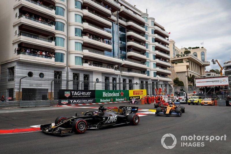 Romain Grosjean, Haas F1 Team VF-19, leads Lando Norris, McLaren MCL34, and Charles Leclerc, Ferrari SF90