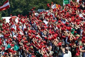 Fans wear red hats in tribute to Niki Lauda