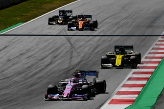 Lance Stroll, Racing Point RP19, leads Daniel Ricciardo, Renault F1 Team R.S.19, Carlos Sainz Jr., McLaren MCL34, and Romain Grosjean, Haas F1 Team VF-19