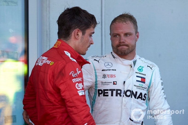 Charles Leclerc, Ferrari, 2nd position, and Valtteri Bottas, Mercedes AMG F1, 3rd position, in Parc Ferme