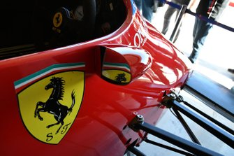 Detail of the logo on the side of a Ferrari