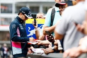 Sergio Perez, Racing Point signs a autograph for a fan
