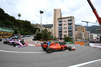 Lando Norris, McLaren MCL34, leads Charles Leclerc, Ferrari SF90, Lance Stroll, Racing Point RP19, and Sergio Perez, Racing Point RP19