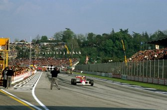 Ayrton Senna, McLaren MP4/5 takes the chequered flag for the win
