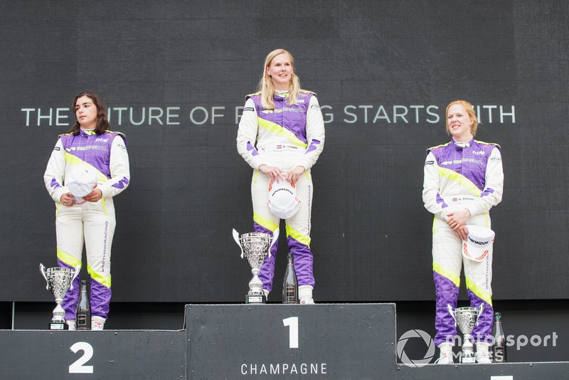 Beitske Visser celebrates on the podium after winning the race with Jamie Chadwick and Alice Powell