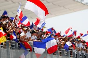 Tricolours are waved in the grandstands