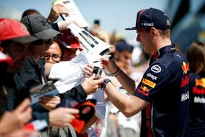 Max Verstappen, Red Bull Racing signs a autograph for a fan