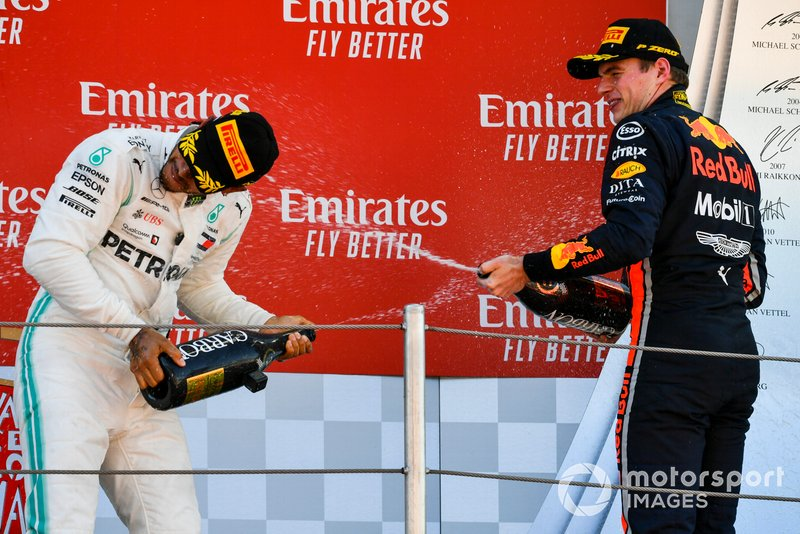 Lewis Hamilton, Mercedes AMG F1, 1st position, sprays Champagne at Max Verstappen, Red Bull Racing, 3rd position, on the podium