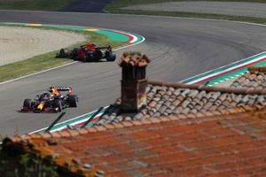 Max Verstappen, Red Bull Racing RB16B, passes Sergio Perez, Red Bull Racing RB16B, who has stopped on track