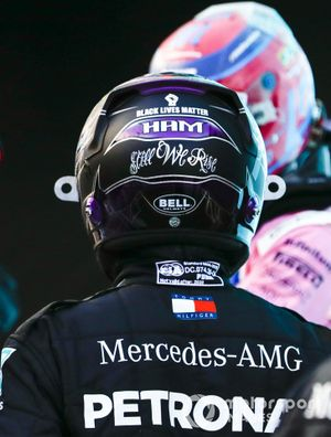 Sergio Perez, Racing Point, and Lewis Hamilton, Mercedes-AMG F1, in Parc Ferme after Qualifying