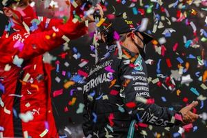 Sebastian Vettel, Ferrari, 3rd position, pours Champagne over Lewis Hamilton, Mercedes-AMG F1, 1st position, on the podium