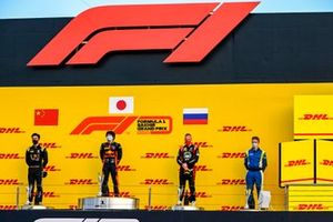 Guanyu Zhou, UNI-Virtuosi, 2nd position, Yuki Tsunoda, Carlin, 1st position, and Nikita Mazepin, Hitech Grand Prix, 3rd position, on the podium