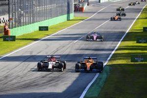 Carlos Sainz Jr., McLaren MCL35 and Kimi Raikkonen, Alfa Romeo Racing C39 battle