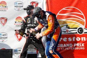 Josef Newgarden, Team Penske Chevrolet, Scott Dixon, Chip Ganassi Racing Honda celebrate on the podium with champagne