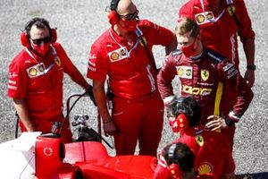 Mick Schumacher is briefed by Ferrari personnel prior to driving his fathers championship winning Ferrari F2004