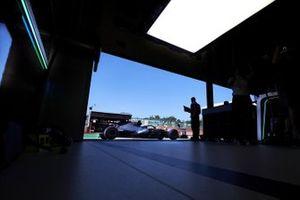 Valtteri Bottas, Mercedes F1 W11, arrives outside the garage
