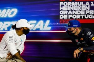 Pole starter Lewis Hamilton, Mercedes-AMG F1, and Max Verstappen, Red Bull Racing, talk in the post Qualifying Press Conference