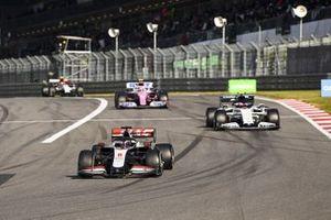 Romain Grosjean, Haas VF-20 and Pierre Gasly, AlphaTauri AT01