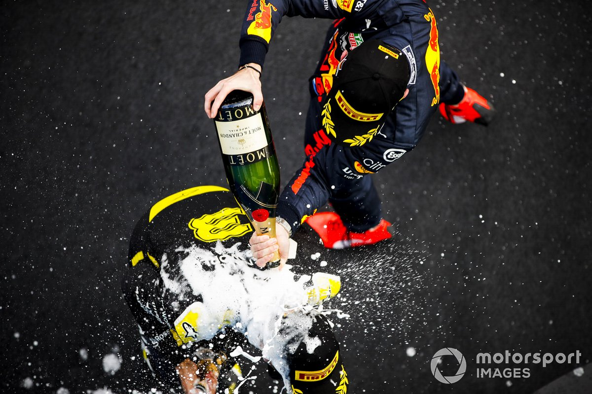 Daniel Ricciardo, Renault F1 and Max Verstappen, Red Bull Racing celebrates on the podium with the champagne