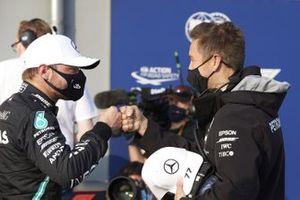 Valtteri Bottas, Mercedes-AMG F1, celebrates with his team mate after securing pole