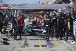 Valtteri Bottas, Mercedes F1 W11, is returned to the garage