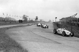 Hans Stuck, Auto Union D, leads Rudolf Hasse, Auto Union D, and Heinz Brendel, Mercedes-Benz W154
