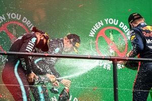 Lewis Hamilton, Mercedes-AMG F1, 1st position, Valtteri Bottas, Mercedes-AMG F1, 2nd position, and Max Verstappen, Red Bull Racing, 3rd position, celebrate with Champagne on the podium