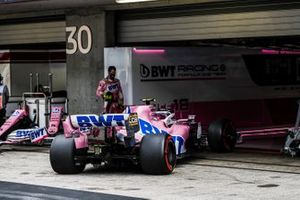 Lance Stroll, Racing Point RP20, pulls into the garage to retire from the race