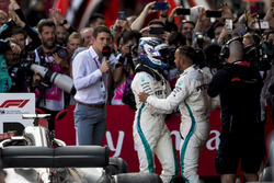 Lewis Hamilton, Mercedes AMG F1, 1st position, celebrates in Parc Ferme with his team mate Valtteri Bottas, Mercedes AMG F1, 2nd position
