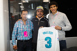 Fernando Alonso, McLaren, receives a signed football shirt from Real Madrid player Jesus Vallejo