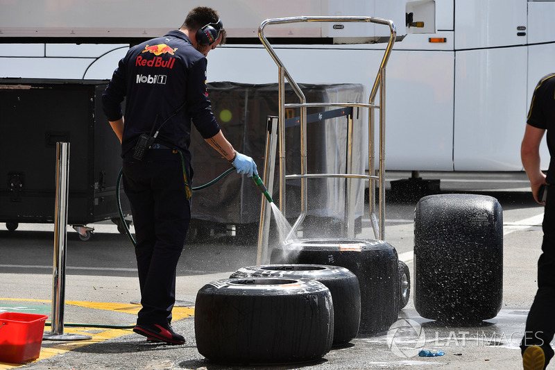 Red Bull Racing mechanic washes Pirelli tyres