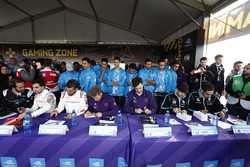 The drivers sign autographs for fans