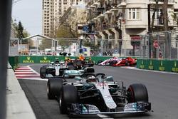 Lewis Hamilton, Mercedes AMG F1 W09, leads Valtteri Bottas, Mercedes AMG F1 W09, Daniel Ricciardo, Red Bull Racing RB14 Tag Heuer, Max Verstappen, Red Bull Racing RB14 Tag Heuer, Kimi Raikkonen, Ferrari SF71H, and Esteban Ocon, Force India VJM11 Mercedes, at the start