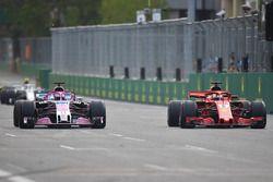 Себастьян Феттель, Ferrari SF71H, и Серхио Перес, Sahara Force India F1 VJM11