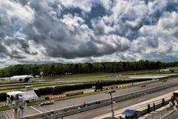 Josef Newgarden, Team Penske Chevrolet leads Sébastien Bourdais, Dale Coyne Racing with Vasser-Sullivan Honda at the restart