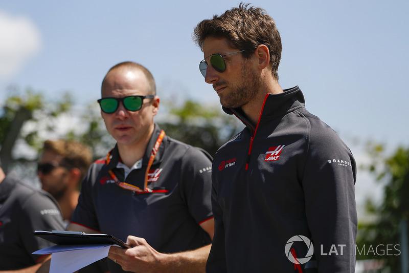 Romain Grosjean, Haas F1 Team, conducts a track walk with colleagues