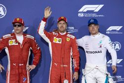 Top three qualifiers Sebastian Vettel, Ferrari, Kimi Raikkonen, Ferrari, and Valtteri Bottas, Mercedes AMG F1