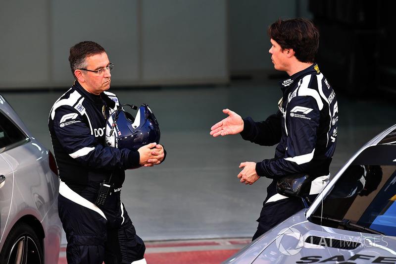 Dr Ian Roberts, FIA Doctor and Alan Van Der Merwe, FIA Medical Car Driver