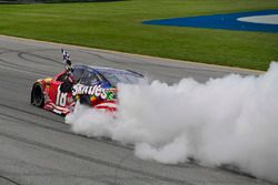 Kyle Busch, Joe Gibbs Racing, Toyota Camry Skittles Red White & Blue celebrates with a burnout after winning