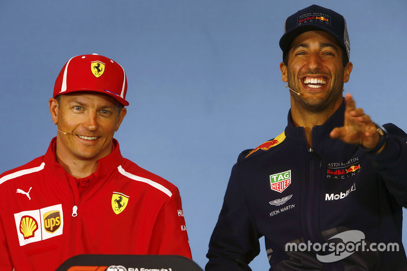 Kimi Raikkonen, Ferrari, and Daniel Ricciardo, Red Bull Racing, share a joke in the Thursday press conference