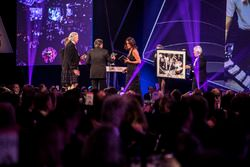 Nelson Piquet receives a lifetime achievement award from Gordon Murray, is presented with a Rainer S