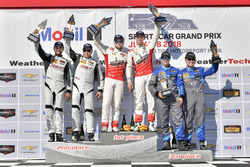 #60 Roush Performance / KohR Motorsports, Ford Mustang GT4, GS: Nate Stacy, Kyle Marcelli celebrates the win on the podium with #80 AWA, Ford Mustang GT4, GS: Martin Barkey, Brett Sandberg, #33 Winward Racing / HTP Motorsport, Mercedes-AMG, GS: Russell Ward, Damien Faulkner