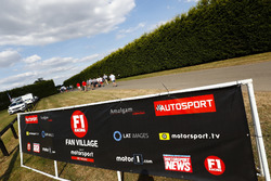 F1 Racing / Autosport hoardings at the entrance to a carpark