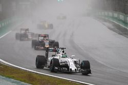 Felipe Massa, Williams FW38 Mercedes, leads Daniil Kvyat, Toro Rosso STR11, and Carlos Sainz Jr, Tor